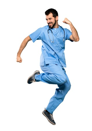 Full-length shot of Surgeon doctor man jumping over isolated white background