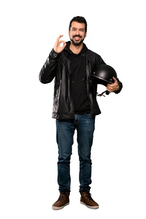 Full-length shot of Biker man showing ok sign with fingers over isolated white background