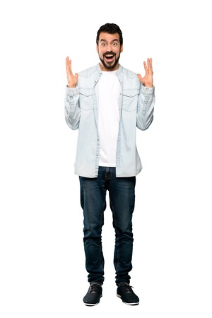 Full-length shot of Handsome man with beard with shocked facial expression over isolated white background