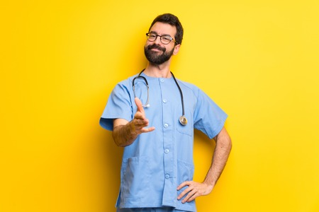 Surgeon doctor man shaking hands for closing a good deal