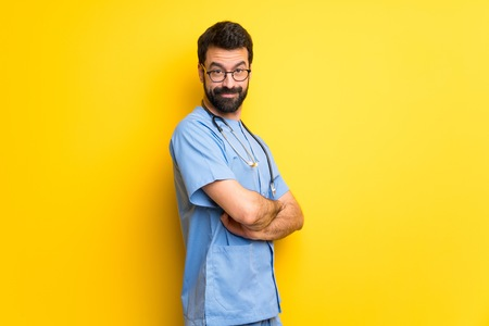 Surgeon doctor man with arms crossed and looking forward