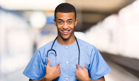 Surgeon doctor man with surprise facial expression in a hospital