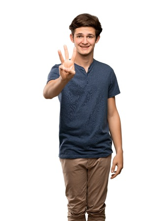 Teenager man happy and counting three with fingers over isolated white background