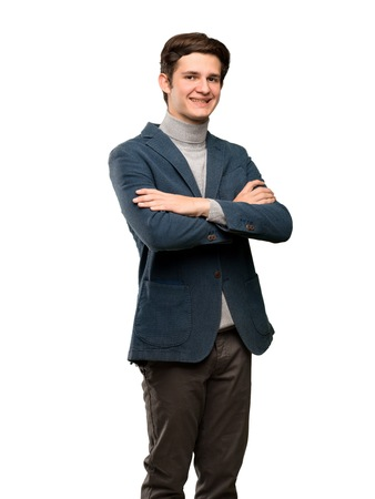 Teenager man with turtleneck with arms crossed and looking forward over isolated white background