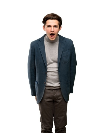Teenager man with turtleneck with surprise facial expression over isolated white background