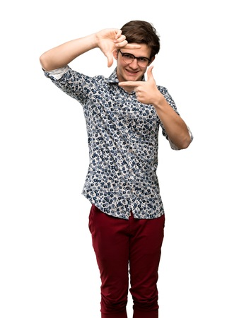 Teenager man with flower shirt and glasses focusing face. Framing symbol over isolated white background