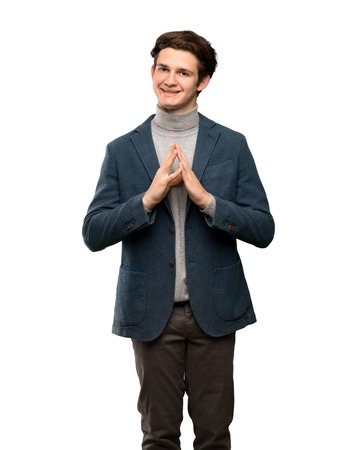 Teenager man with turtleneck scheming something over isolated white background