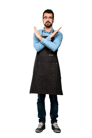 Full-length shot of Man with apron making NO gesture over isolated white background