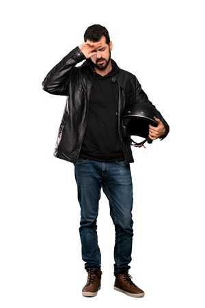 Full-length shot of Biker man with tired and sick expression over isolated white background