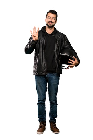 Full-length shot of Biker man happy and counting four with fingers over isolated white background