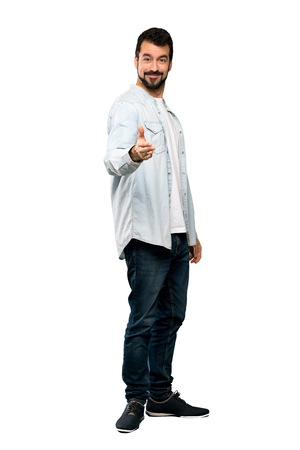 Full-length shot of Handsome man with beard shaking hands for closing a good deal over isolated white background
