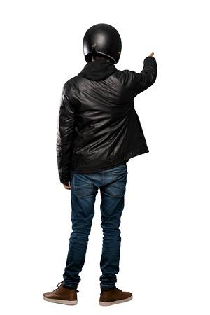 Full-length shot of Biker man over isolated white background