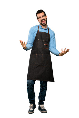 Full-length shot of Man with apron smiling over isolated white background