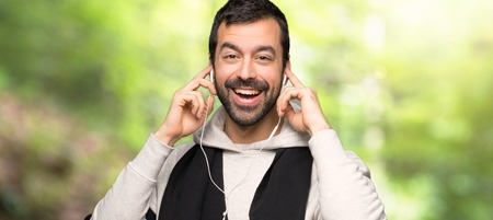 Sport man with headphones in a park