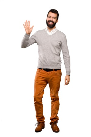Handsome man saluting with hand with happy expression over isolated white background