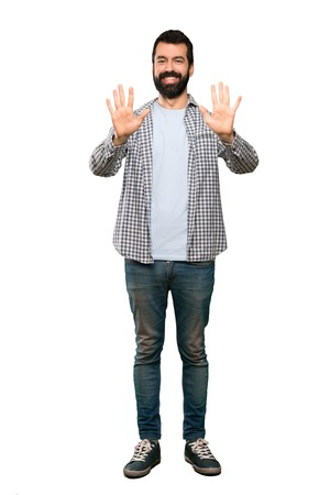 Handsome man with beard counting ten with fingers over isolated white background Stock Photo