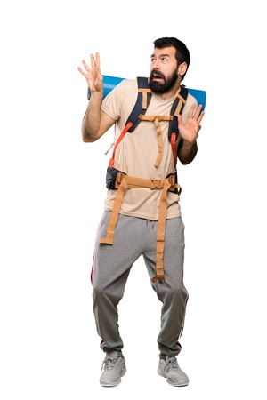 Hiker man nervous and scared over isolated white background Stock Photo