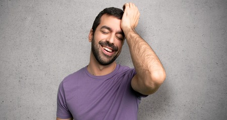 Handsome man has just realized something and has intending the solution over textured wall