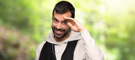 Sport man saluting with hand in a park Stock Photo