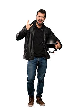 Full-length shot of Biker man making rock gesture over isolated white background