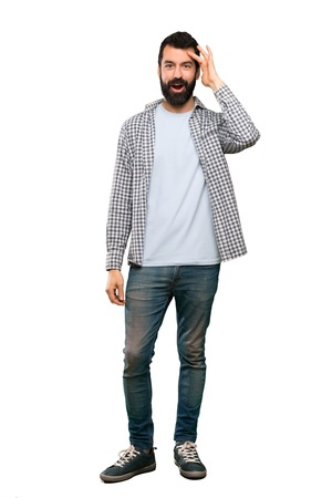 Handsome man with beard has just realized something and has intending the solution over isolated white background
