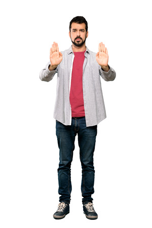 Full-length shot of Handsome man with beard making stop gesture and disappointed over isolated white background Imagens