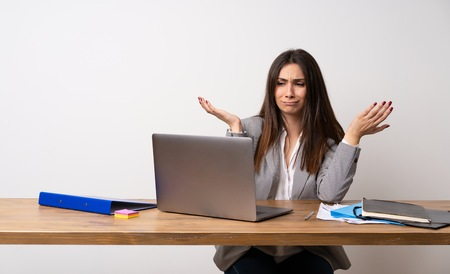 Business woman in a office unhappy because not understand something Stock Photo