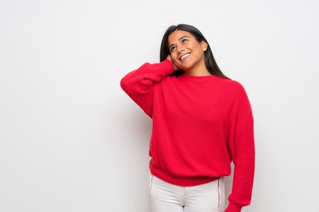 Young Colombian girl with red sweater thinking an idea Stock fotó