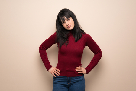 Young woman with red turtleneck angry 写真素材