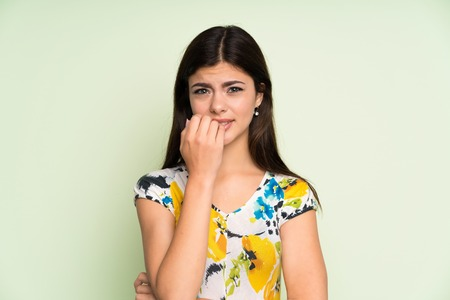 Teenager girl with floral dress nervous and scared