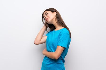 Teenager girl with blue shirt thinking an idea 免版税图像