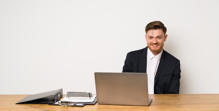 Businessman in a office laughing
