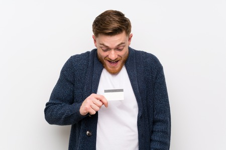 Redhead man holding a credit card