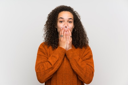 Dominican woman over isolated white wall with surprise facial expression