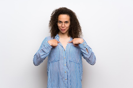Dominican woman with striped shirt with surprise facial expression