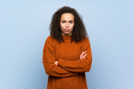 Dominican woman with curly hair feeling upset