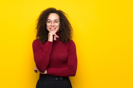 Dominican woman with turtleneck sweater smiling and looking to the front with confident face 免版税图像