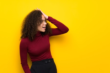 Dominican woman with turtleneck sweater has just realized something and has intending the solution