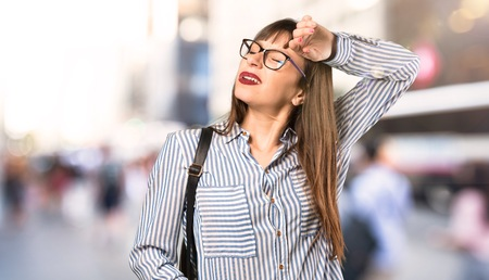 Woman with glasses with tired and sick expression at outdoors Imagens