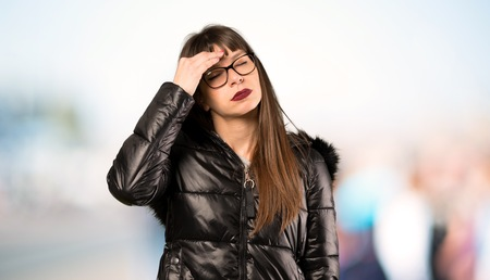 Woman with glasses with headache at outdoors
