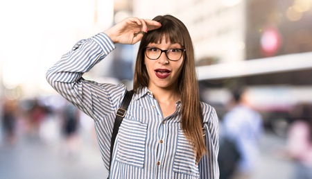 Woman with glasses has just realized something and has intending the solution at outdoors 스톡 콘텐츠