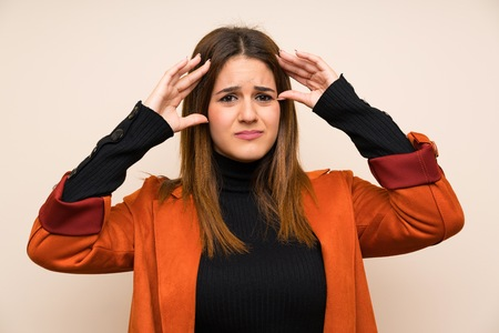 Young woman with coat unhappy and frustrated with something. Negative facial expression
