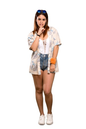 Full-length shot of Young woman in bikini in summer holidays showing a sign of silence gesture putting finger in mouth over isolated white background