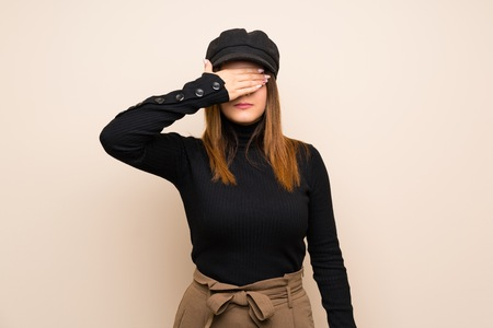 Fashion woman with hat covering eyes by hands. Do not want to see something Stockfoto - 123080020