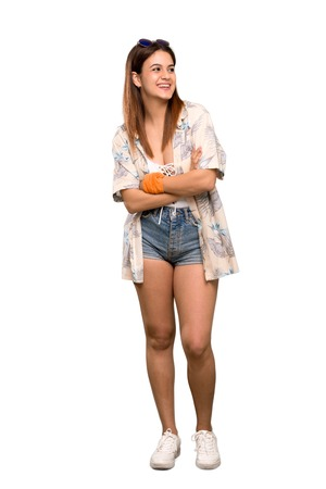 Full-length shot of Young woman in bikini in summer holidays happy and smiling over isolated white background