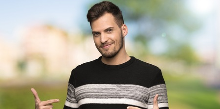 Handsome man proud and self-satisfied at outdoors