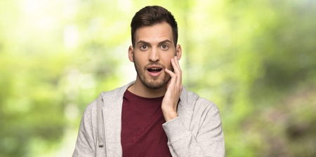 Man with sweatshirt with surprise and shocked facial expression in a park Stok Fotoğraf