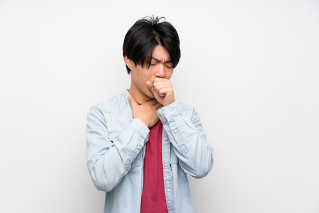 Asian man on isolated white background is suffering with cough and feeling bad