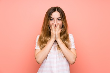 Young woman over isolated pink wall with surprise facial expression Archivio Fotografico
