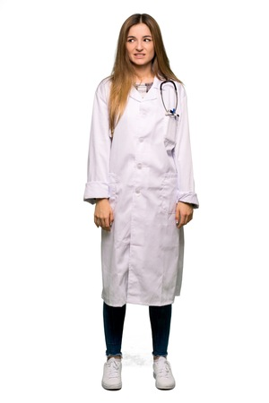 Full body Young doctor woman is a little bit nervous and scared pressing the teeth on isolated background